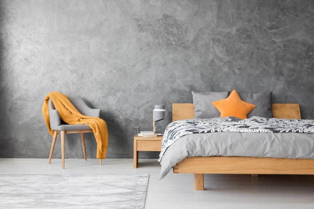 betonlook slaapkamer muur